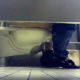 A hidden camera records 3 unsuspecting women using a public restroom toilet in a stall. 2 women appear to be pissing. One woman sits there for a while and seems to be wiping her ass.  Audio is somewhat muffled. Over 7 minutes.