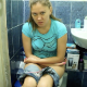 A girl records herself shitting while sitting on a toilet in her own bathroom. There are 4 scenes. In two scenes, she records herself from behind looking down, so we can see the poop coming out. Poop sounds are also nicely audible. Over 10 minutes.