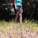 This crystal-clear, high-quality video features a woman taking a piss and a shit on the ground in grassy meadow outdoors. Presented in 720P HD. Over 3.5 minutes.