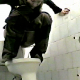 A woman is video-recorded pissing & shitting while squatting above a toilet. The view is clear, but there is no audio.