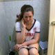 Adriana wears her sports jersey while taking a shit sitting on a toilet. She complains of cramps. Wet farts and shitting are heard. She wipes her ass thoroughly when finished. No poop is seen. Presented in 720P HD. Over 7 minutes.