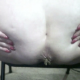 A fat woman places her ass close to the camera and takes a shit.