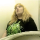 A fat, blonde girl records herself using an airplane toilet. There is a lot of background noise, but we can see her pushing, straining, and wiping. Presented in 720P HD. About 3 minutes.