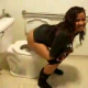 Amy is caught on video peeing while standing over a toilet at a Hookah bar.