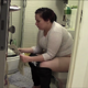 A fat Eastern-European girl pisses and farts repeatedly while sitting on a toilet and reading a paper. She grunts and pushes trying to shit, but has trouble because she says she is being watched. No pooping. About 6 minutes..