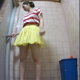 A hidden camera records an unsuspecting Japanese woman taking a piss and massive, long shit into a public floor toilet. Presented in 720P vertical HD format. About 2.5 minutes.