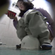 A hidden camera records an unsuspecting Japanese girl as she takes a piss and a shit into a floor toilet. No poop is seen, but we can hear some subtle shitting sounds as well as a lot of grunting and sighing. About 5.5 minutes.