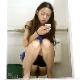 A hidden camera in an Asian public restroom records an unsuspecting pretty girl taking a shit into a floor toilet while checking messages on her cell phone and even taking a phone call. About 10.5 minutes.