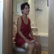 A Japanese woman sits on a toilet and talks. We have no idea what she is saying, and we are not sure if she has peed or pooped. No pooping sounds that we could hear.