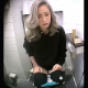 A pretty Asian girl with blondish hair is recorded by a hidden camera pissing into a toilet in several scenes and shitting in at least one scene. Audio is too muffled to hear details. Presented in vertical 720P HD format. About 5 minutes.