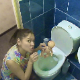 An attractive Eastern-European girl abuses her plastic doll by placing it in the toilet and taking a shit on top of it. See movies 6213, 6412, 8098 and 9008 for more. Over 7 minutes.