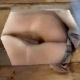 A woman is video-recorded from underneath an outhouse floor opening as she takes a shit. Unfortunately, this cameraman sucks, and he focuses more on her private parts than the ongoing poop action.