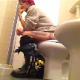 A short-haired brunette girl with dyed highlights sits down on a toilet. She pisses, then shits about a minute into the clip with subtle, multiple plops. She farts after the plops quiet down, then starts pooping again. About 4.5 minutes.