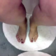 "A woman video records herself peeing and pooping from a ""between the knees"" perspective. No action is visible within the toilet bowl, but we can hear everything clearly."