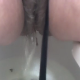 A girl video-records herself from between the legs as she pees and poops. Low frame-rate video, but some nice sounds.