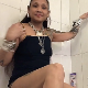 A mature, Asian woman with tattoos and facial piercings takes a massive shit and a piss while standing in a bath tub. Presented in 720P HD. About 2 minutes.