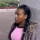 A black girl takes a piss in a public location in the city.