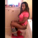 A black girl sits on a toilet, pees, and then takes a shit. She describes what she ate, how the poop smells, and when it is coming out. Unfortunately, the pooping sounds are barely audible, and she does not show the poop.