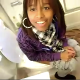 A black girl is seen sitting on a toilet taking a dump while having a weird dialogue with her friend filming her. We get to see her strain and clearly hear the plop!
