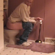 A blonde woman takes a piss and a shit in 3 scenes while sitting on a toilet. In one scene, the smell seems to attract her own dog. Audible pooping, but older video quality. About 25 minutes.