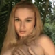 A pretty blonde woman takes a firm shit on the ground in a secluded outdoor location. Over 4 minutes.