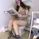 A plump, masked girl farts and shits while sitting on a toilet in multiple, edited shots. She even tells us a story about a bad poop incident from college. Over 10.5 minutes.