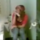 A pretty Spanish girl is seen peeing on a toilet.