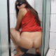 An attractive Brazilian girl wearing sunglasses takes a shit on the shower floor.