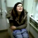 A brunette British girl with glasses is videotaped peeing on the toilet by her girlfriends.