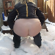 A plump, blonde woman takes a small, runny shit onto the snow in her own backyard. Presented in 720P HD. Over 2 minutes.