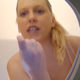 A fat, blonde, German girl records herself taking a hard, nuggety shit into a makeshift portable toilet rigged with a bowlcam. Finished product shown. Over 4 minutes.