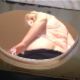 A plump, blonde German girl takes a piss and a hard, wide, chunky shit into a makeshift outhouse box for bowlcam style, visible poop and piss action. Over 2 minutes.