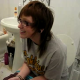 A girl wearing glasses has the longest shit of her life while sitting on the toilet. It just keeps coming out! Pay attention to the cute girl sitting on the edge of the tub. She starts cutting some farts, too! Great video!