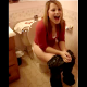 A short but sweet video clip of a girl peeing while sitting on a toilet with her mouth gaping open.