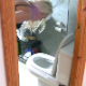 A blonde, Dutch girl rushes into the bathroom and attempts to shit into a toilet while bending over in front of it. She mostly misses and hits the seat instead. 2 angles shown. Presented in 720P HD. Over 5 minutes.