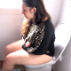 A plump Italian girl pushes and strains while sitting on a toilet. She seems a little over-dramatic. There is a small, audible plop at 2:14 and a small fart heard at 3:11. Presented in 720P HD. Over 5.5 minutes.