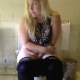 A plump, blonde girl sits down on a toilet. A huge explosion and a few wet, followup plops/drips are heard as she takes a shit. She wipes her ass and cleans the toilet bowl when finished. Presented in 720P HD. Exactly 3 minutes.
