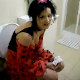 A very brief, but clear clip of a cute punker girl after she took a shit while sitting on a toilet and prepares to wipe herself. She seems very shy. No audible pooping sounds.
