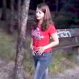A pretty Czech girl positions herself to pee in a trash can at a public park, but changes her mind when she realizes that what she really has the urge to do is shit.