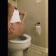 A pretty brunette girl takes a shit sitting backwards on a toilet and once again onto the floor with a hard, wide chunky shit. Presented in 720P vertical HD format. About 3 minutes.
