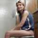 "Dee farts as soon as she sits down on the toilet and realizes that she has ""more than just gas"". You can hear the plop of a turd hitting the water, and she complains to her roommate about the smell."