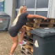A plump, pretty, German girl climbs on top of a stack of wooden pallets, then shits and pisses into a trash bin beneath her. Presented in 720P HD. Over 2.5 minutes.