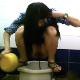 This voyeur video features 5 different women taking runny shits and pissing into a public toilet in Thailand. Apparently, the toilet has no running water, and the girls have to pour water down the drain with a plastic container. 5 minutes.