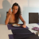 An attractive girl is eating at the dining room table while taking a shit onto the floor at the same time. Very high-quality video!
