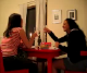 Two girls offer a toast at dinner and begin to drink their glasses of wine, when all of a sudden, the girl on the left lets out a horrendously, deep, long fart and shocks her friend!