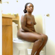 An attractive black woman records herself shitting while sitting on a toilet in 4 scenes. Pooping sounds are audible, but no poop is shown. Great narration, too. Over 9.5 minutes.