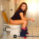 A medium resolution JPEG image of a very pretty woman pooping on a toilet. THIS IS AN IMAGE, NOT A MOVIE!
