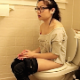 A cute Asian-American girl with glasses farts, takes a shit and a piss while sitting on a toilet. She wipes her ass when finished. Poop sounds are audible, but no action or finished product shown. Presented in 720P HD format. About 5 minutes.