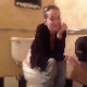 A slender, young-looking girl wearing sunglasses records herself pissing and supposedly taking a shit while sitting on a toilet in a public restroom. No audible pooping sounds are heard. About 2 minutes.