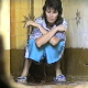 A woman is observed from a hole in the wall as she pees & poops in a filthy, Eastern European outhouse floor toilet.